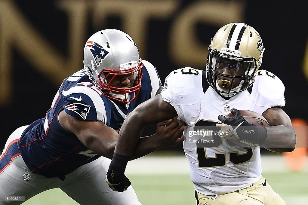 Khiry Robinson #29 of the New Orleans Saints is pursued by Xzavier Dickson #42 of the New England Patriots during the second quarter of a preseason game at the Mercedes-Benz Superdome on August 22, 2015 in New Orleans, Louisiana.