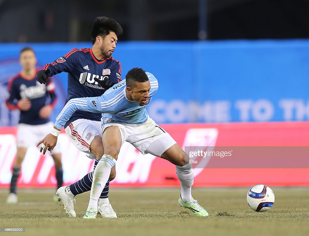 Khiry Shelton #19 of New York City FC and Lee Nguyen #24 of New England Revolution fight for the ball in the second half during the inaugural game of the New York City FC at Yankee Stadium on March 15, 2015 in the Bronx borough of New York City.The New York City FC defeated the New England Revolution 2-0.