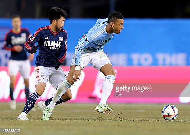 Khiry Shelton of New York City FC and Lee Nguyen of New England Revolution fight for the ball in the second half during the inaugural game of the New...