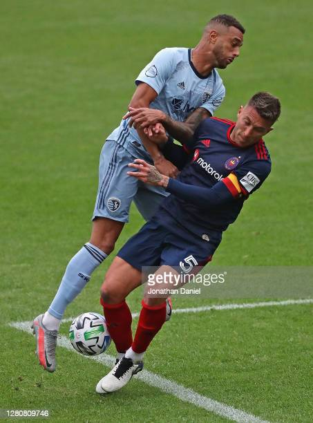 Khiry Shelton of Sporting Kansas City collides with Francisco Calvo of Chicago Fire at Soldier Field on October 17, 2020 in Chicago, Illinois....