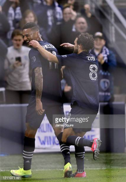 Khiry Shelton of Sporting Kansas City is congratulated by Graham Zusi after scoring during the game against the Houston Dynamo at Children's Mercy...