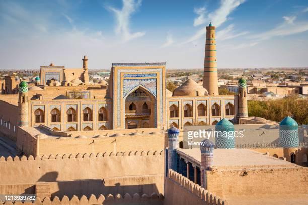 khiva itchan kala islam cityscape and islam khoja minaret uzbekistan - minaret stock pictures, royalty-free photos & images