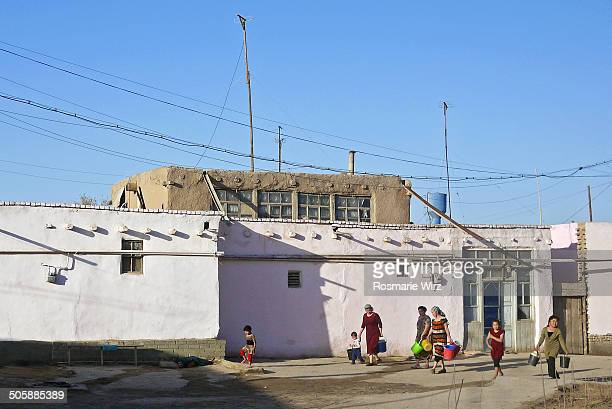 Khiva outer city where inhabitants fetch water early in the morning.
