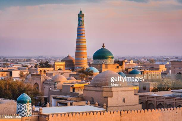 khiva sunset twilight xiva хива islam khoja minaret uzbekistan - muziek stock pictures, royalty-free photos & images