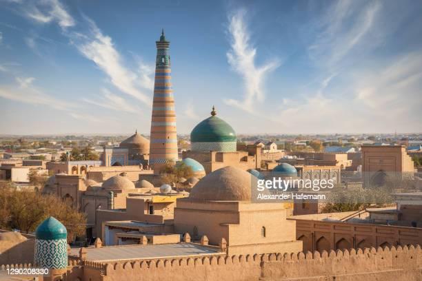 khiva uzbekistan old town xhiva ichan qala islam khodja minaret aerial city view - minaret stock pictures, royalty-free photos & images