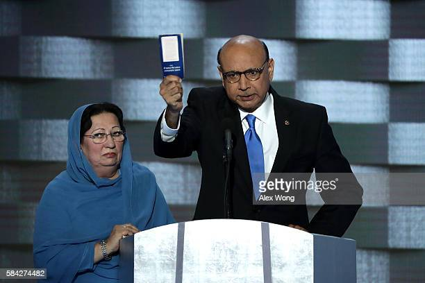 Khizr Khan father of deceased Muslim US Soldier Humayun S M Khan holds up a booklet of the US Constitution as he delivers remarks on the fourth day...