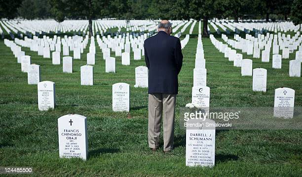 Khizr Khan pauses at the grave of his son Army Captain Humayun Saqib Muazzam Khan who died while serving in Iraq at Arlington National Cemetery...