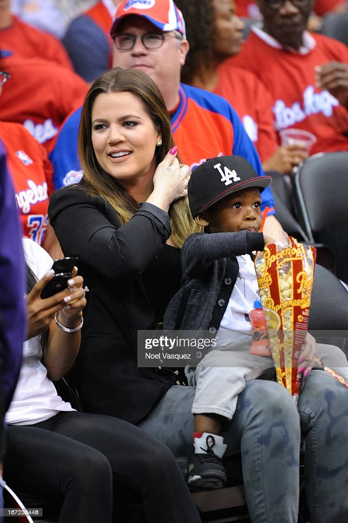 Khloe Kardashian and her godson attend a playoff basketball game between the Memphis Grizzlies and the Los Angeles Clippers at Staples Center on April 22, 2013 in Los Angeles, California.