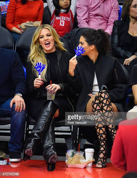 Khloe Kardashian and Kendall Jenner attend a basketball game between the Houston Rockets and The Los Angeles Clippers at Staples Center on May 8,...
