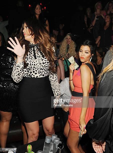 Khloe Kardashian and Kourtney Kardashian celebrate Kim Kardashian's bachelorette party at TAO Nightclub at the Venetian on July 23 2011 in Las Vegas...