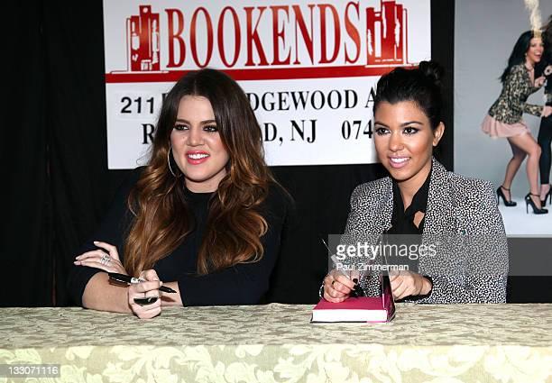 "Khloe Kardashian and Kourtney Kardashian promote the new book ""Dollhouse"" at Bookends Bookstore on November 16, 2011 in Ridgewood, New Jersey."