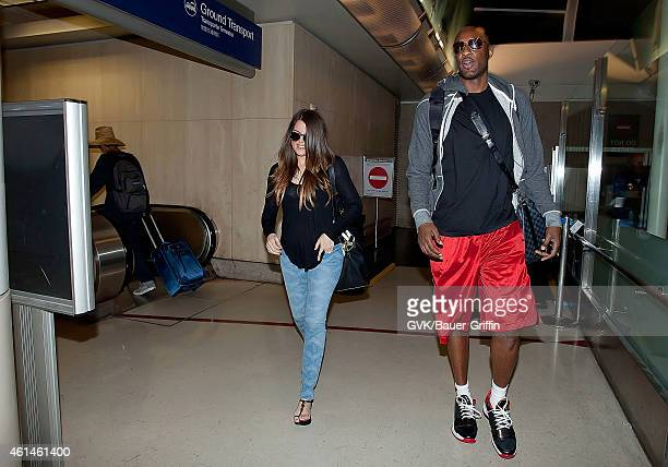 Khloe Kardashian and Lamar Odom are seen at Los Angeles International Airport on July 22 2012 in Los Angeles California