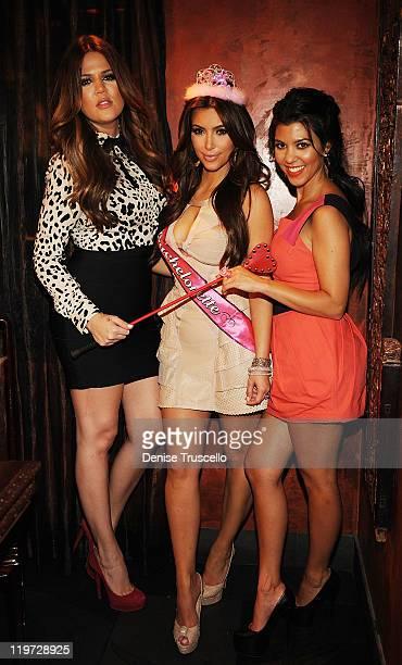 Khloe Kardashian Kim Kardashian and Kourtney Kardashian attend Kim Kardashian's bachelorette dinner at TAO Bistro at the Venetian on July 23 2011 in...
