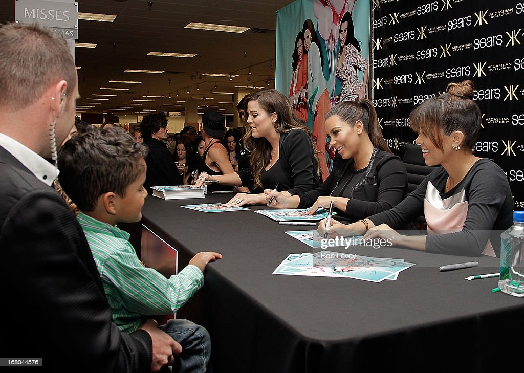 Khloe Kardashian Odom, Kim Kardashian and Kourtney Kardashian sign autographs for fans during a Sears In-Store Appearance For Kardashian Kollection at Willowbrook Mall on May 4, 2013 in Houston, Texas.