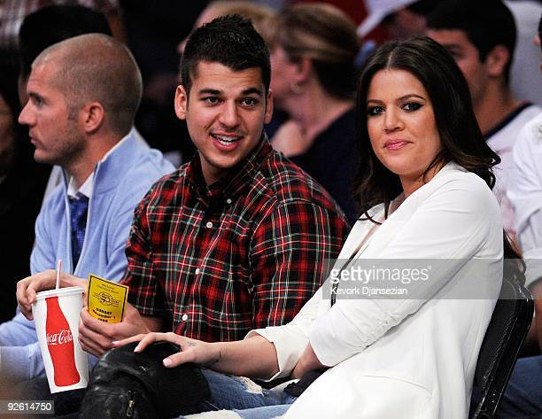 Khloe Kardashian wife of Los Angeles Lakers Lamar Odom and her brother Rob Kardashian follow the action during the NBA basketball game against...