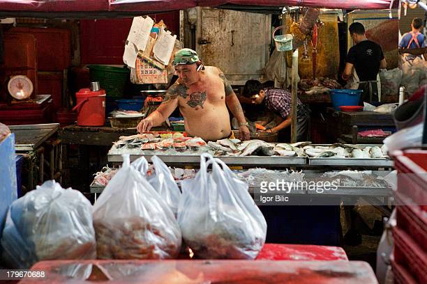 CONTENT] Khlong Toey is a district in central Bangkoklong known for its notorious slum Khlong Toey market is packed with shouting market vendors...