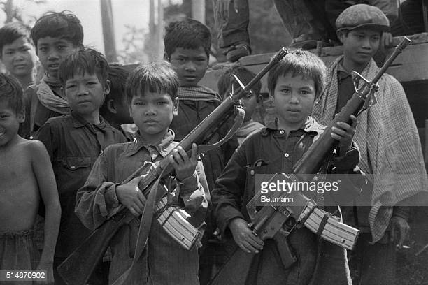 Khmer boys no more than 12 years old holding M16 rifles | Location Galaw Cambodia