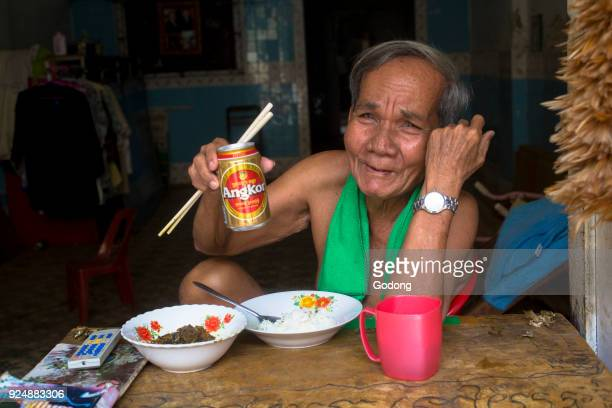 Khmer eating lunch in his Battambang home Cambodia