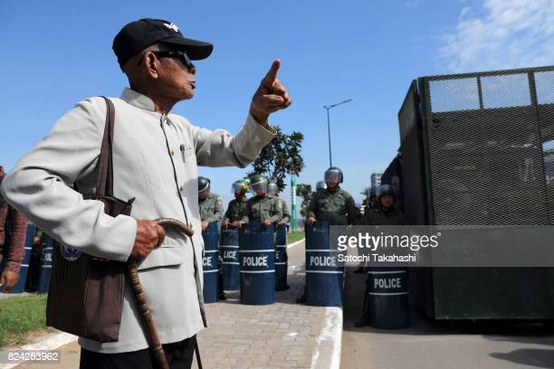 Khmer Krom activist confronts riot police during a march to the National Assembly to submit a petition seeking a new national holiday marking the day...