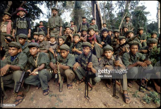 Khmer Rouge guerrillas at a base camp in the Cardamom Mountains of western Cambodia north of Pailin 8th February 1981