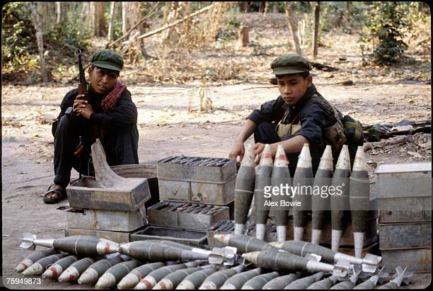 Khmer Rouge guerrillas in the Cardamom Mountains of Cambodia with Vietnamese mortar rounds which originally belonged to the US army captured during...