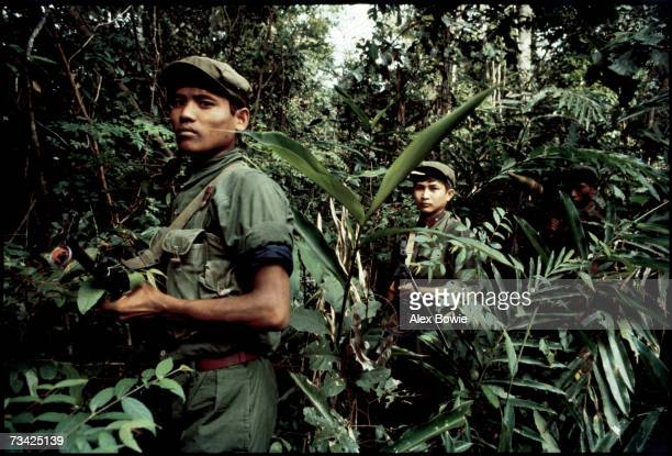Khmer Rouge guerrillas in the jungle of western Kampuchea north of Pailin in the Chardanrom Mountains region as they attempt to halt advancing...