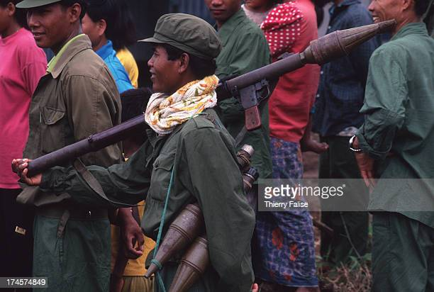 Khmer Rouge soldier marching past a crowd
