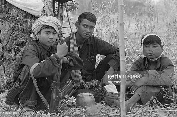 Khmer Rouge soldiers rest in last ditch defensive position a half mile from the Thai border Soldier with white bandage has infected shrapnel wound...