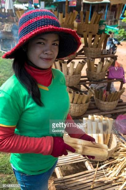 1d5e4522fc9b4 Khmer woman making and selling sticky rice in bamboo Cambodia