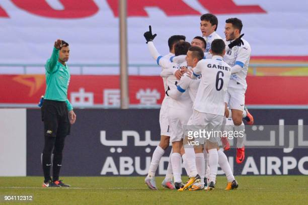 Khojiakbar Alijonov of Uzbekistan celebrates with team mates after scoring his team's first goal during the AFC U23 Championship Group A match...