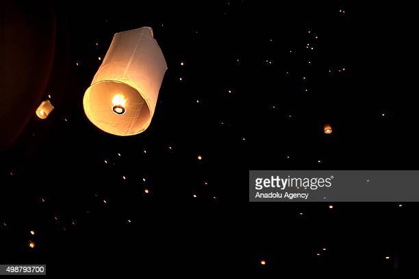 Khom Loi are seen on the sky during the opening ceremony of Yi peng festival at the Ta Pae street in Chiengmai Thailand on November 25 2015