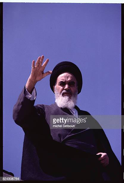 Khomeini returning to Tehran saluting the crowd from the roof of his house in Qom Qom Iran