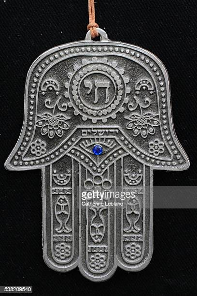 khomsa. the hand of fatima. the hamesh hand or hamsa hand is a popular motif in jewish jewelry. - hand of fatima stock photos and pictures