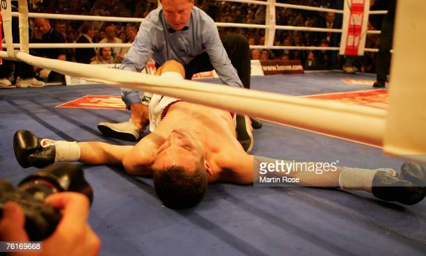 Khoren Gevor of Germany lies on the ground after he was knocked out by Arthur Abraham during the IBF World Championship Middleweight fight between...