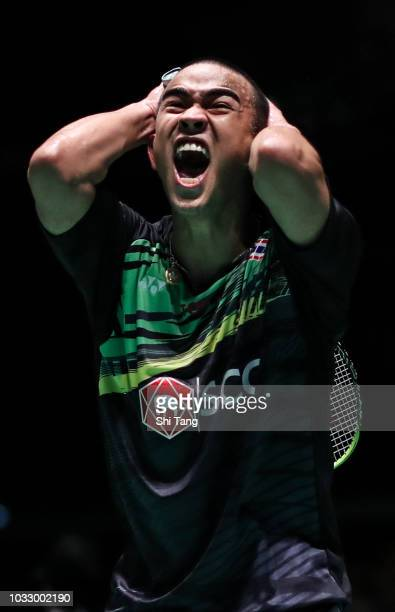 Khosit Phetpradab of Thailand celebrates the victory after the Men's Singles quarter finals against Chen Long of China on day four of the Yonex Japan...
