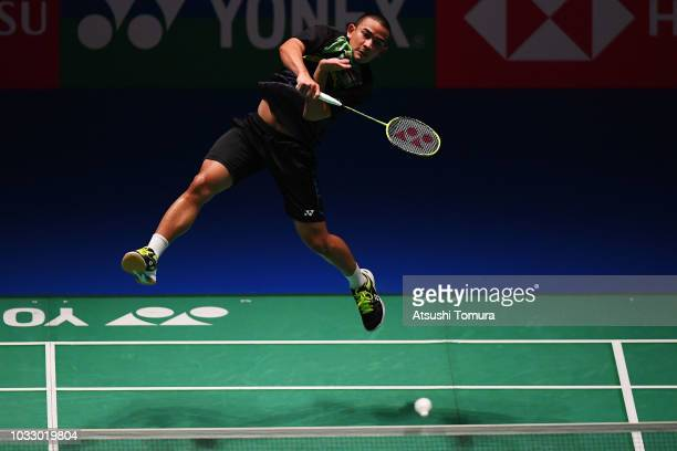 Khosit Phetpradab of Thailand competes in the Men's Singles quarter final match against Chen Long of China on day four of the Yonex Japan Open at...