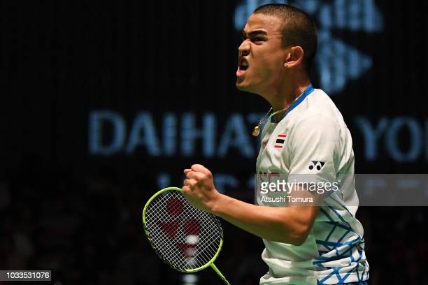 Khosit Phetpradab of Thailand competes in the Men's singles semi final match against Lee Dong Keun of South Korea on day five of the Yonex Japan Open...