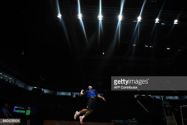 Khosit Phetpradab of Thailand hits a return against Jonatan Christie of Indonesia during the men's singles badminton final at the 29th Southeast...