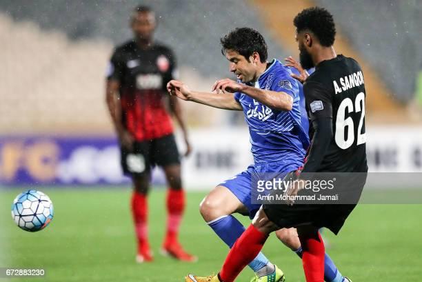 Khosro Heydari of Esteghlal and Abdelaziz Sanoour in action during AFC Champions League match between Esteghlal vs Al Ahli FC at Azadi Stadium on...