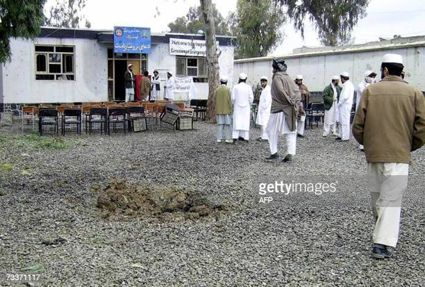 Afghan locals stand at the site of a suicide attack at a hospital in the eastren Afghan city of Khost 20 February 2007 A suicide bomber dressed in a...