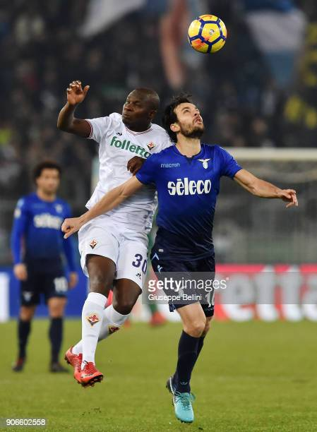 Khouma Babacar of ACF Fiorentina and Marco Parolo of SS Lazio in action during the TIM Cup match between SS Lazio and ACF Fiorentina at Olimpico...