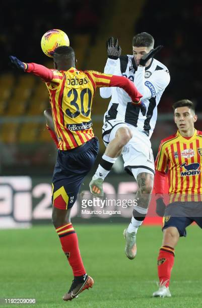 Khouma Babacar of Lecce competes for the ball with Rodrigo De Paul of Udinese during the Serie A match between US Lecce and Udinese Calcio at Stadio...