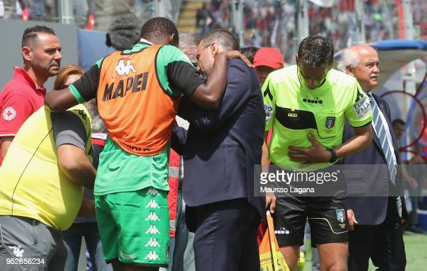Khouma Babacar of Sassuolo and first referee assistant Giulio Dosobz get injured during the serie A match between FC Crotone and US Sassuolo at...