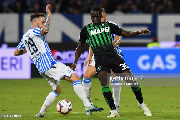 Khouma Babacar of Sassuolo competes for the ball with Manuel Lazzari of Spal during the serie A match between SPAL and US Sassuolo at Stadio Paolo...
