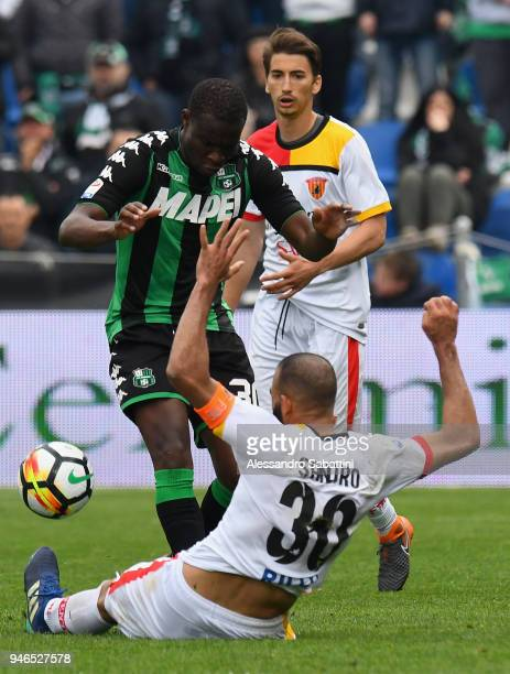 Khouma Babacar of US Sassuolo competes for the ball whit Sandro of Benevento Calcio during the serie A match between US Sassuolo and Benevento Calcio...