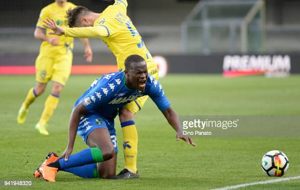 Khouma Babacar of US Sassuolo competes with Alessandro Gamberini AC Chievo Verona during the serie A match between AC Chievo Verona and US Sassuolo...