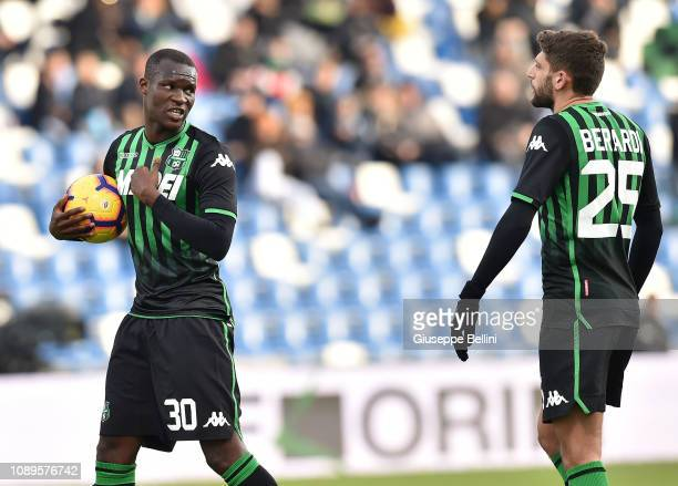 Khouma Babacar of US Sassuolo speaks with Domenico Berardi before kicking the penalty during the Serie A match between US Sassuolo and Cagliari at...