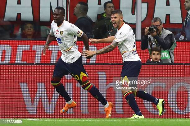 Khouma El Hadji Babacar of US Lecce celebrates his goal with his team-mate Marco Calderoni during the Serie A match between AC Milan and US Lecce at...