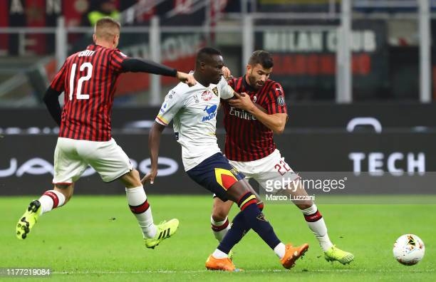 Khouma El Hadji Babacar of US Lecce competes for the ball with Mateo Musacchio of AC Milan during the Serie A match between AC Milan and US Lecce at...