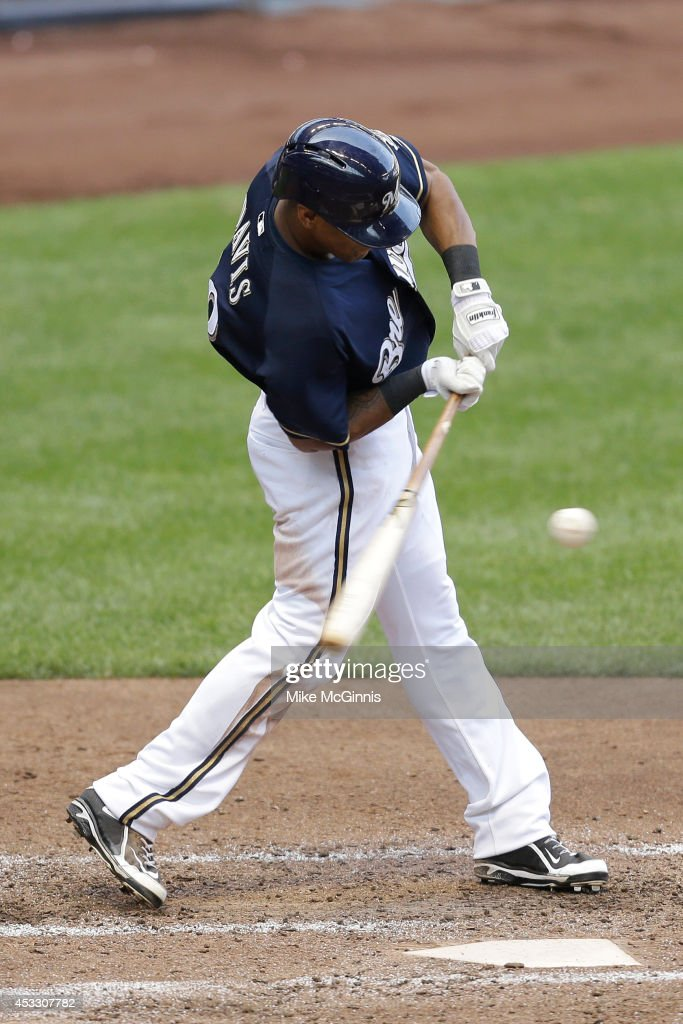 Khris Davis #18 of the Milwaukee Brewers hits a RBI double in the bottom of the sixth inning against the San Francisco Giants at Miller Park on August 07, 2014 in Milwaukee, Wisconsin.